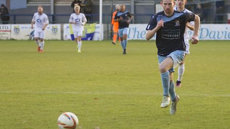 Tom Meechan burst forwards during St Neots Town's victory against Basingstoke. Picture: CLAIRE HOWES