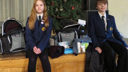 Twins Olivia and Daniel Humphreys are donating items to the homeless this year. Picture: ABBEY COLLE