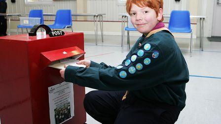 Scouting Card Delivery - Edward Husbands, 10, posting christmas cards.Picture: Karyn Haddon.