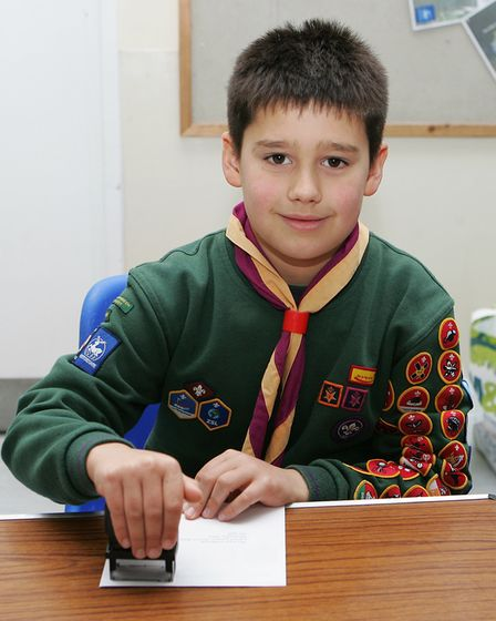 Scouting Card Delivery - John Dent , 8, stamping christmas cards.Picture: Karyn Haddon.