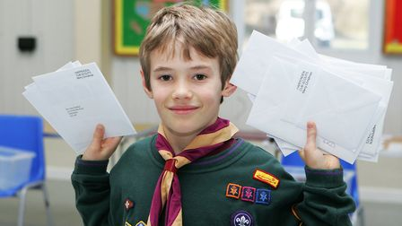 Scouting Card Delivery - William Rodger, 9, enjoys the scouting card delivery day.Picture: Karyn H