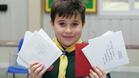 Scouting Card Delivery - George Downes, 10, enjoys posting the christmas cards.Picture: Karyn Hadd