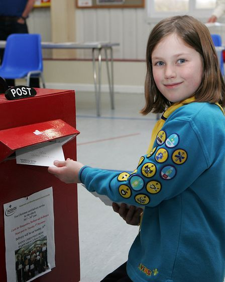 Scouting Card Delivery - Lauren Antcliff, 7, enjoys posting the christmas cards.Picture: Karyn Had