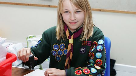 Scouting Card Delivery - Nina Mahendra , 10, stamping christmas cards.Picture: Karyn Haddon.