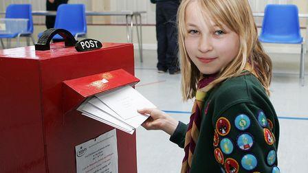 Scouting Card Delivery - Nina Mahendra , 10, enjoys posting the christmas cards.Picture: Karyn Ha