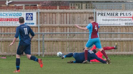 Martin Turner (10) slides in to equalise for Brampton in their derby success at Eaton Socon. Picture