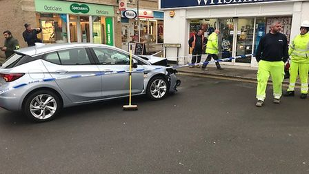 The car which crashed into the shop