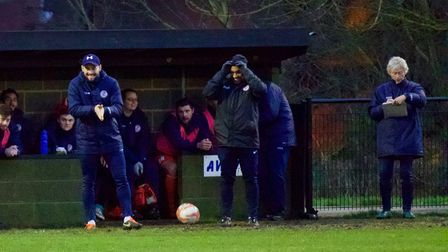 Assistant boss Jack Cassidy (left) in the St Ives Town dugout for the final time. Picture: LOUISE TH