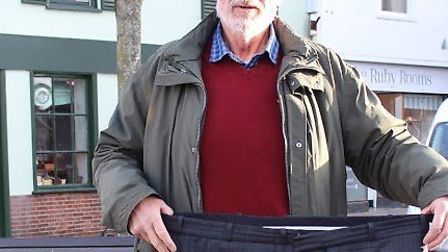 Royston slimmer Tony Reynolds, 71, shows off a pair of trousers he used to wear before losing more t