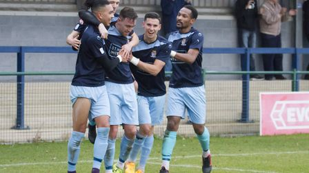 St Neots Town players celebrate their second goal - from Lewis Irwin (left) - in the victory against