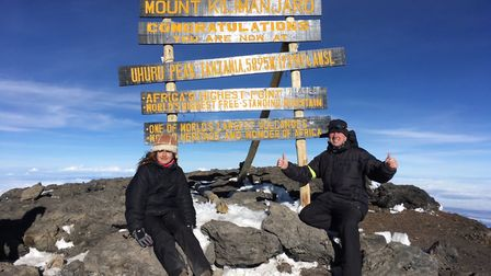 Annabel and Paul at the top of Mount Kilimanjaro.