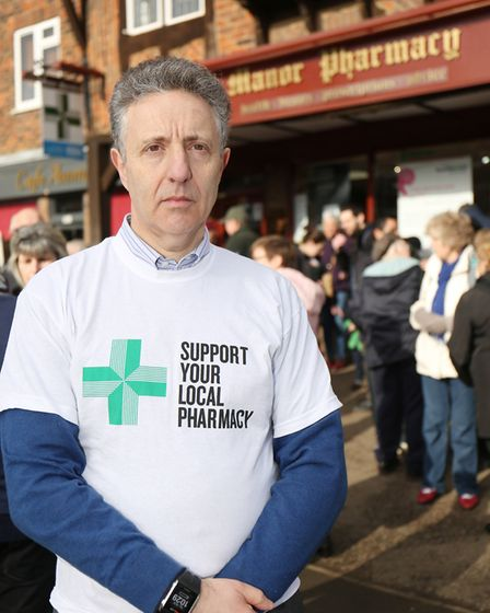 Director of Manor Pharmacy Group Graham Phillips with a crowd of local protestors gathered to suppor