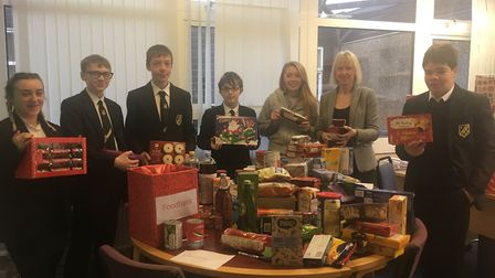 Acting headteacher Kim Horner with Meridian students sorting through the foodbank donations. Picture