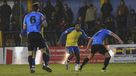 Shaun Lucien takes on the Harrogate defence. Picture: BOB WALKLEY