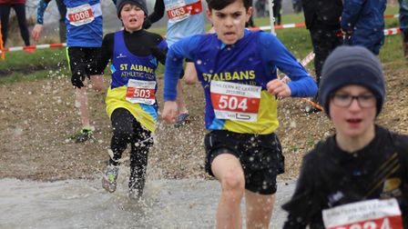 St Albans Athletics Club's U13s show grit and determination as they plough through the water at the