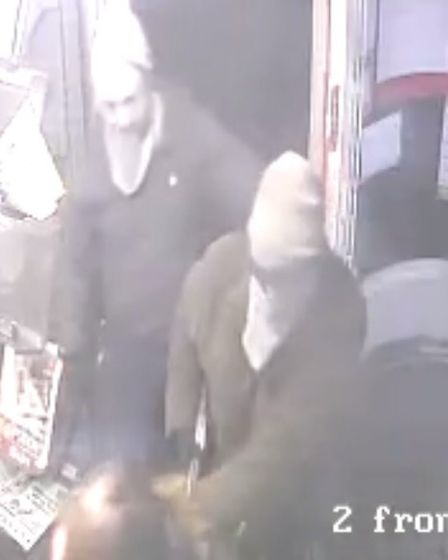 The two men entered the shop with masks over their faces.