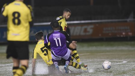 Snow sprays up as Toby Lees tackles Shaun Lucien. Picture: BOB WALKLEY