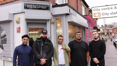 Hairdressers at Menspire gave free cuts to homeless people on Christmas Day. Picture: Josh Lamonaca