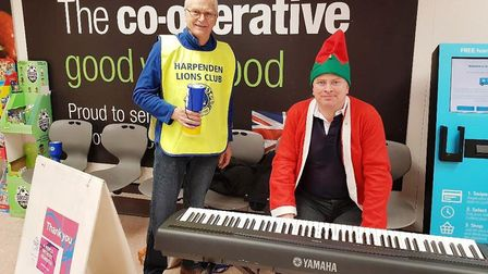 Lions Paul and James play Christmas songs for Dementia Friends.