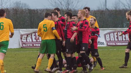 Tempers flare following a tackle from Oakham United captain Stewart Lambie (5) on Huntingdon Town ma