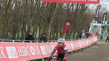Beatrice Pauley cross the finish line at the National Cyclocross Championships.