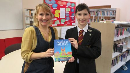 College artist Beth Lievesley, pictured with son Archie, who has donated the Cambridge Art Book feat