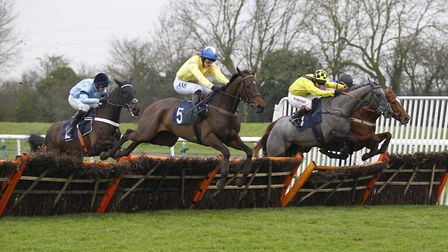 Esprit De Somoza and Lizzie Kelly (number five) win the Chatteris Fen Juvenile Hurdle at Huntingdon
