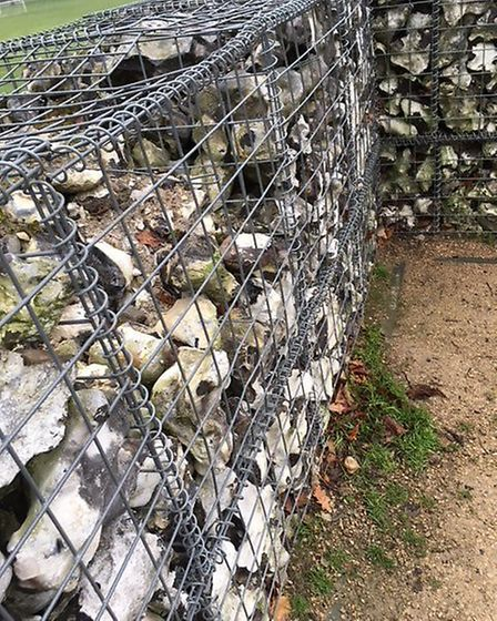 Vandalism to reconstructed wall around the Roman Hypocaust.