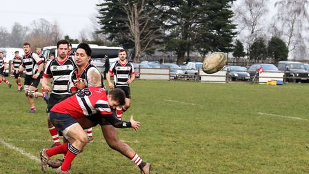 Bobby Tane feels the force of the tackle but still manages to flick the ball away. Picture: MELANIE