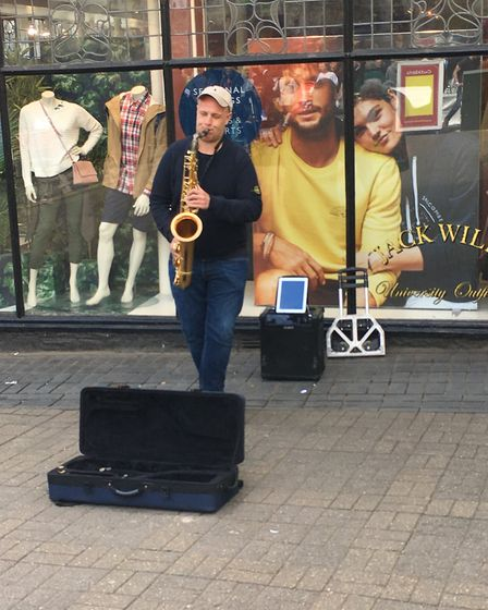 A busker outside Jack Wills in St Albans.