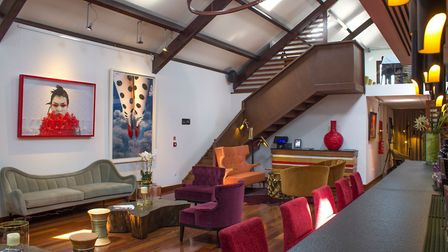 Art goes art deco: The paintings add a dramatic focal point in this cosy and colourful mid-century o