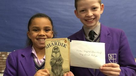 Kimbolton pupils holding the returned library book.