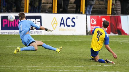 Sam Merson slots home past the advancing Laurie Walker. Picture: LEIGH PAGE