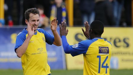 Sam Merson celebrates the Saints first goal of the game with new signing Shaquille Hippolyte-Patrick