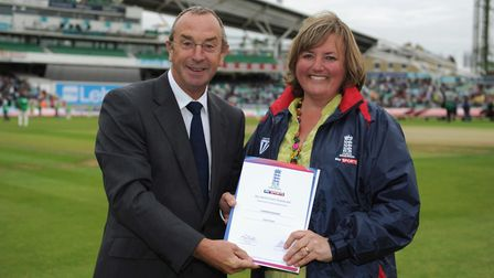 Lisa Turner being presented with a Sky Sports coaching award by David Lloyd at The Oval during a te
