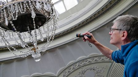 Industrial archaeologist Dr Ian West got 15m up in the air to inspect the crystal gas light. Picture