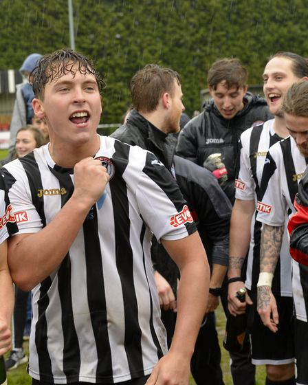 Current St Neots player Harry O'Malley celebrates winning promotion with St Ives back in 2016.