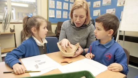 DIG: Archaeologist Tori Guy shows a pot found at Fenstantont to pupils