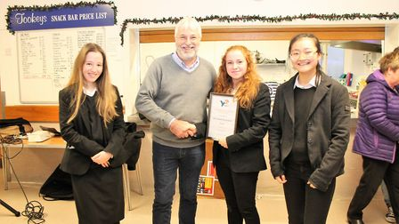 Members of team Prosperity receieve their award from chairman of the organising board Chris Newsome.
