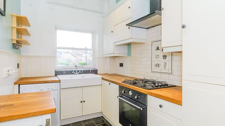 The kitchen has a double Belfast sink