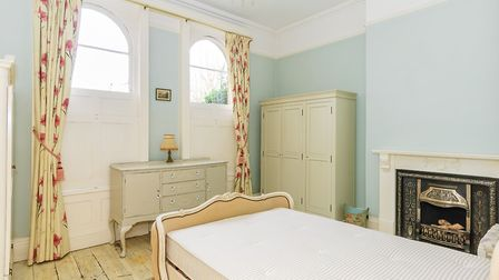Sash windows with elliptical tops are one of the property's stand-out features