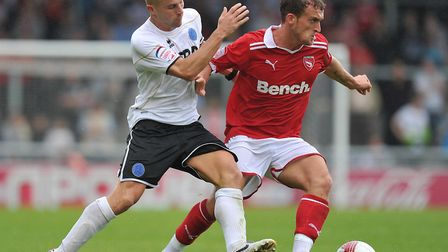 Morecambe's Lewis Alessandra (right) and Aldershot Town's Ben Herd battle for the ball during the np