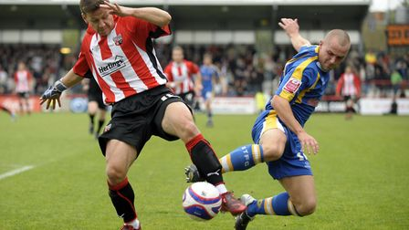 Brentford's Charlie MacDonald and Shrewsbury's Ben Herd in action during the Coca-Cola League Two ma