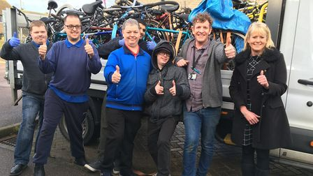 CHUFFED: The TAG Bikes team with Robert Bierton, employment skills worker, and Sarah Collett, from G