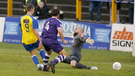 Sam Merson slots the ball past Lukas Lidakevicius. Picture: LEIGH PAGE