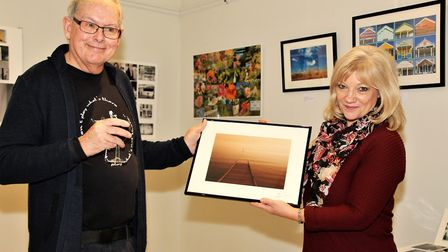 Photographer David Hone LRPS with Donna Sleight, who purchased a piece of work called 'submerged'. P