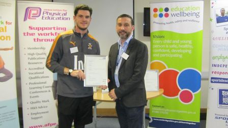 Liam Smith receiving his award from Cllr Bywater