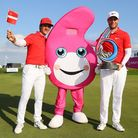 Thorbjorn Olesen and Lucas Bjerregaard of Denmark pose with the trophy and the GolfSixes mascot afte