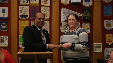 Rajesh Joshi, President of the Rotary Club of St Albans Verulamium presents a cheque for £1000 to Li
