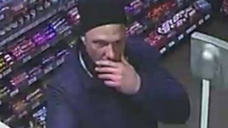 An image of the man, wearing a black beanie and a blue coat, who police wish to speak to.